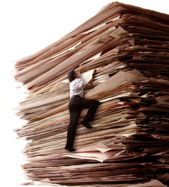 Man Climbing Stack of Paper