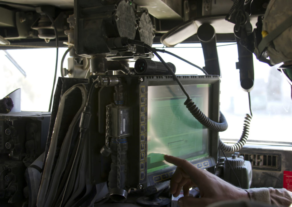 Touch Screen LCD Panel mounted in HMMWV as part of the Blue Force Tracker / FBCB2 system. Soldier is preparing system to go out on a combat patrol.